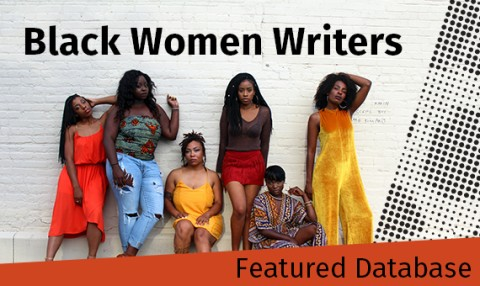 Black women pose against a brick wall